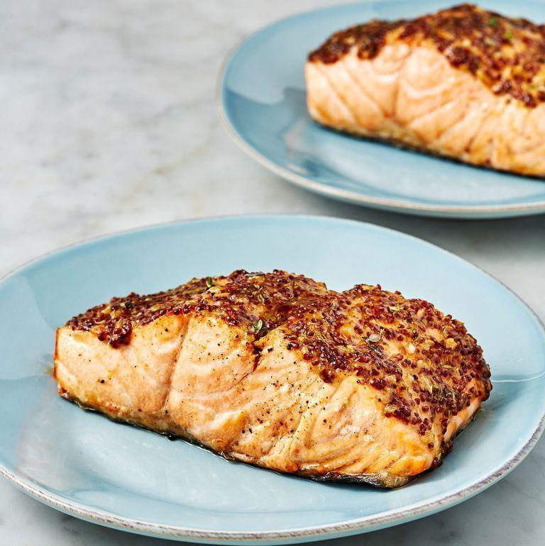 """<p>Ten minutes — that's all it takes to make this tender and delicious salmon with a sweet mustard topping.</p><p><em><a href=""""https://www.delish.com/cooking/recipe-ideas/a28141940/air-fryer-salmon-recipe/"""" rel=""""nofollow noopener"""" target=""""_blank"""" data-ylk=""""slk:Get the recipe from Delish »"""" class=""""link rapid-noclick-resp"""">Get the recipe from Delish »</a></em></p><p><a class=""""link rapid-noclick-resp"""" href=""""https://shop.goodhousekeeping.com/delish-party-in-an-air-fryer.html"""" rel=""""nofollow noopener"""" target=""""_blank"""" data-ylk=""""slk:SHOP DELISH'S AIR FRYER COOKBOOK"""">SHOP DELISH'S AIR FRYER COOKBOOK</a></p>"""