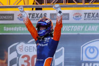 Scott Dixon celebrates in Victory Lane after winning an IndyCar auto race at Texas Motor Speedway in Fort Worth, Texas, Saturday, June 6, 2020. (AP Photo/Tony Gutierrez)