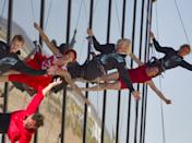 Sir Richard Branson performs with a aerial artists as he repels down the side of the new Spaceport America hangar.