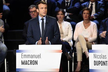 Emmanuel Macron of the political movement En Marche ! (Onwards !) attends a prime-time televised debate for the candidates at French 2017 presidential election in La Plaine Saint-Denis