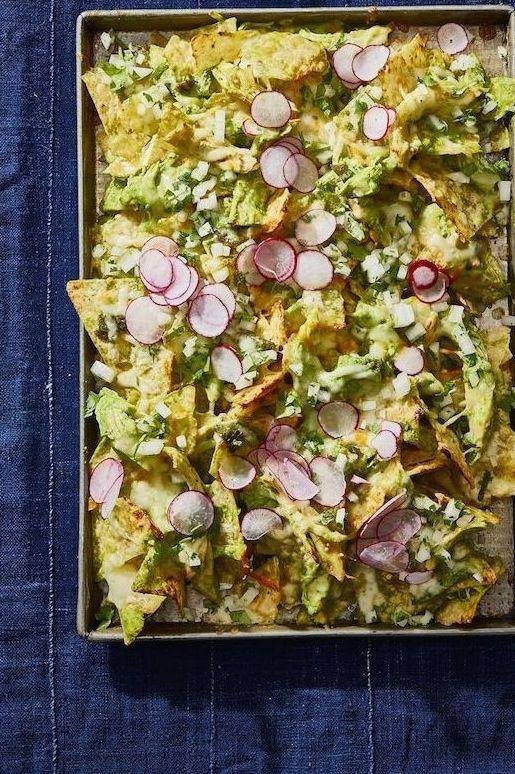 "<p>Our secret to a perfect plate of nachos is to toss all of the ingredients instead of layering (for the best ratio of toppings to chips). Try it with these tasty chicken nachos.</p><p><em><a href=""https://www.goodhousekeeping.com/food-recipes/a29738674/chicken-suizas-nachos-recipe/"" rel=""nofollow noopener"" target=""_blank"" data-ylk=""slk:Get the recipe for Chicken Suizas Nachos »"" class=""link rapid-noclick-resp"">Get the recipe for Chicken Suizas Nachos »</a></em></p><p><strong>RELATED:</strong> <a href=""https://www.goodhousekeeping.com/food-recipes/easy/g755/chicken-breast-recipes/"" rel=""nofollow noopener"" target=""_blank"" data-ylk=""slk:60+ Chicken Breast Recipes That Are Anything But Boring"" class=""link rapid-noclick-resp"">60+ Chicken Breast Recipes That Are Anything But Boring</a></p>"
