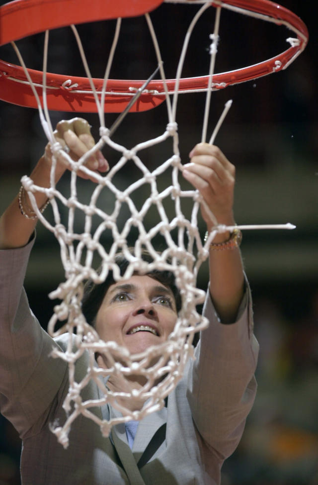 FILE - In this March 25, 2002, file photo, Tennessee associate head coach Mickie DeMoss helps cut the net following her team's victory over Vanderbilt in the NCAA Midwest Regional championship game, in Ames, Iowa. Connecticut assistant coach Chris Dailey and former Tennessee assistant Mickie DeMoss are breaking new ground this weekend when they get inducted into the Women's Basketball Hall of Fame. This marks the first time in the organization's 20-year history that it has inducted anyone based on accomplishments as an assistant coach. (AP Photo/Nati Harnik, File)