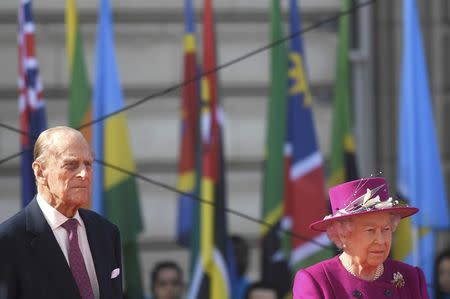 Britain's Queen Elizabeth and Prince Philip take part in the launch of the Queen's baton Relay for the XX1 Commonwealth Games to be held on Australia's Gold Coast next year, on the forecourt of Buckingham Palace in London, March 13, 2017. REUTERS/Toby Melville