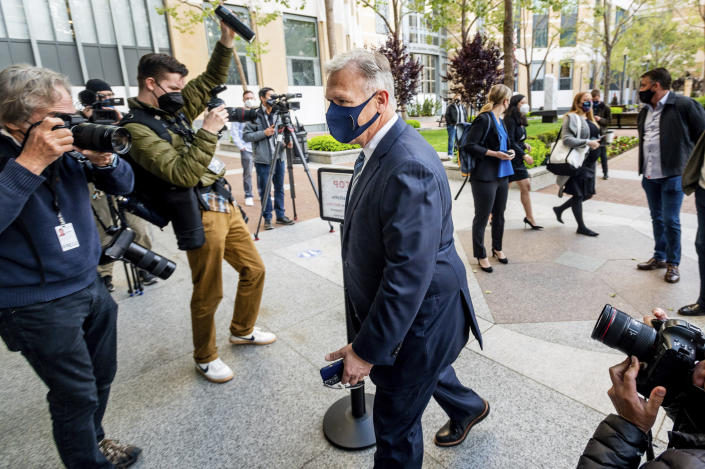 Phil Schiller, an Apple executive, enters the Ronald V. Dellums building in Oakland, Calif., on Monday, May 3, 2021, to attend a federal court case brought by Epic Games. Epic, maker of the video game Fortnite, charges that Apple has transformed its App Store into an illegal monopoly. (AP Photo/Noah Berger)