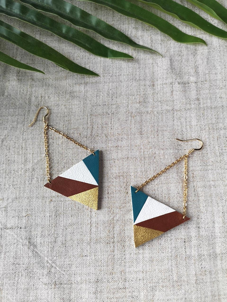 Blue, white, brown and golden earrings with chain for her. Image via Etsy.