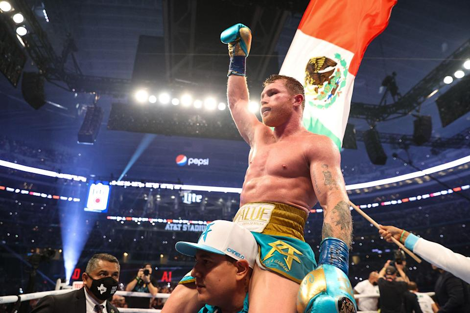 Canelo Alvarez celebrates unifying the super-middleweight division (Getty)