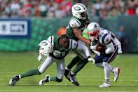 <p>New York Jets corner back Morris Claiborne (21) loses his helmet as he and New York Jets linebacker Darron Lee (58) tackle New England Patriots running back James White (28) during the third quarter at MetLife Stadium. Mandatory Credit: Brad Penner-USA TODAY Sports </p>
