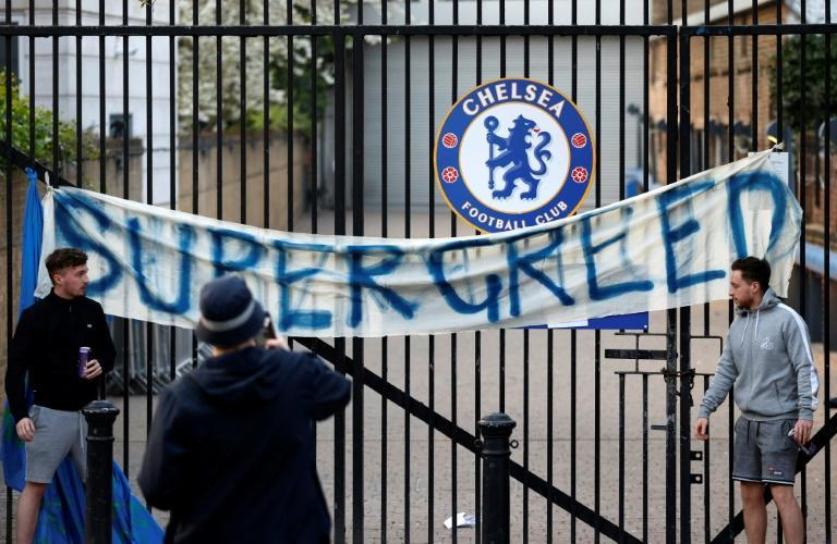Football fans demonstrate against the proposed European Super League outside Chelsea's Stamford Bridge stadium