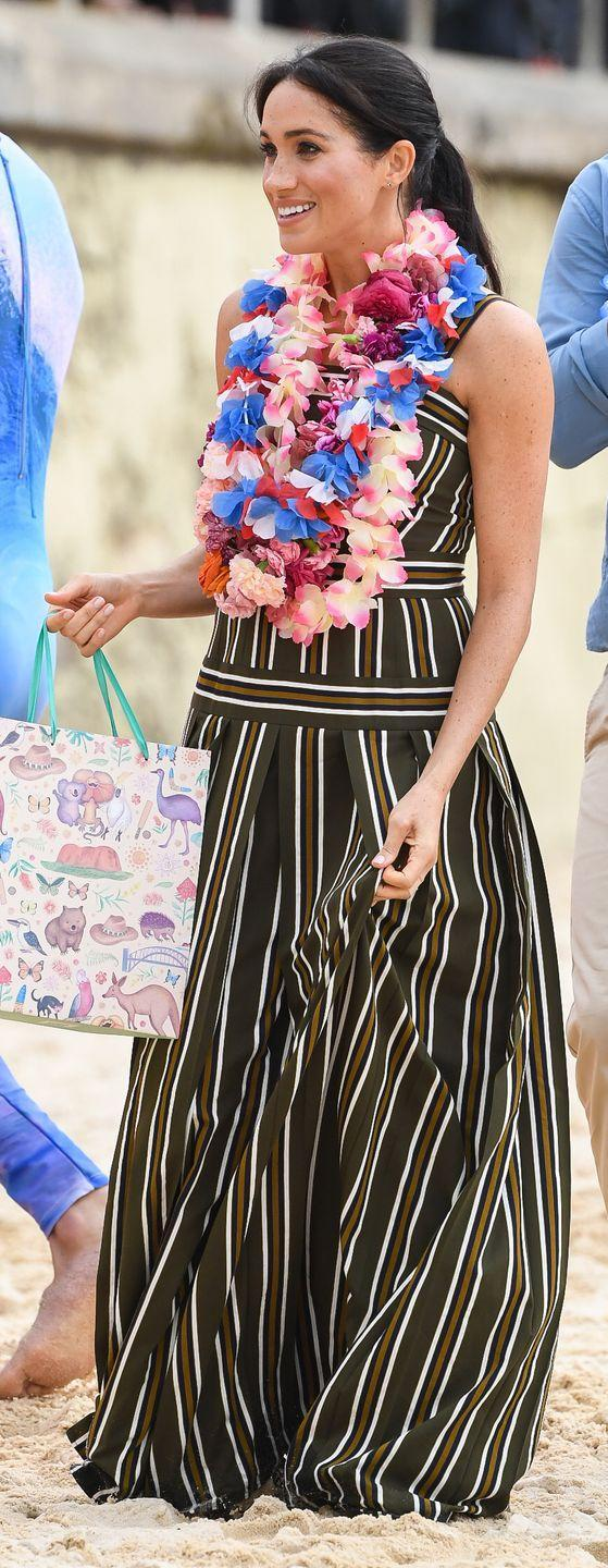 """<p>Meghan Markle first wore this striped maxi dress on royal tour during the early months of her first pregnancy. However, the Duchess re-wore the frock on <a href=""""https://www.elle.com/fashion/personal-style/g28423/maternity-style-evolution/?slide=150"""" rel=""""nofollow noopener"""" target=""""_blank"""" data-ylk=""""slk:royal tour postpartum"""" class=""""link rapid-noclick-resp"""">royal tour postpartum</a>, proving that maternity wear can have a longer lifespan than one thought. </p>"""