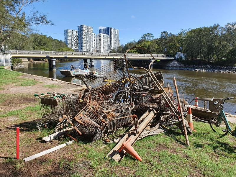 Garbage is pictured removed from Cooks River, Sydney.