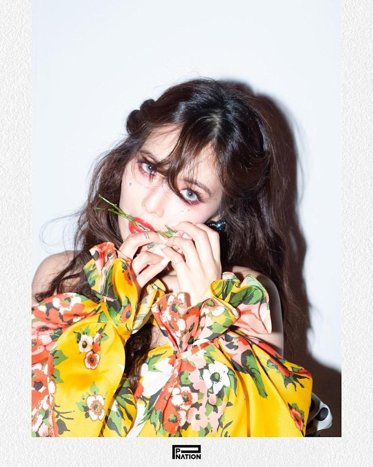 "Before dropped her first single under P Nation titled, <a href=""https://www.youtube.com/watch?v=8xqSz6_RJeU"" target=""_blank"">""Flower Shower,""</a> <strong>HyunA</strong> shared teasers, complete with twinkling makeup and an ethereal half-up do. Rhinestones were glued onto the apples of her cheeks in an asymmetrical arrangement for added glam."