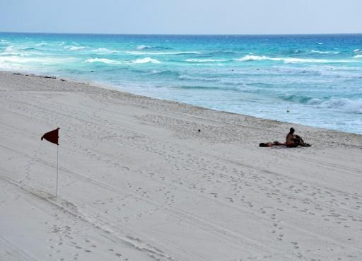 Two lone tourists enjoy a Cancun beach all to themselves in March after Mexico imposed a lockdown over the coronavirus pandemic