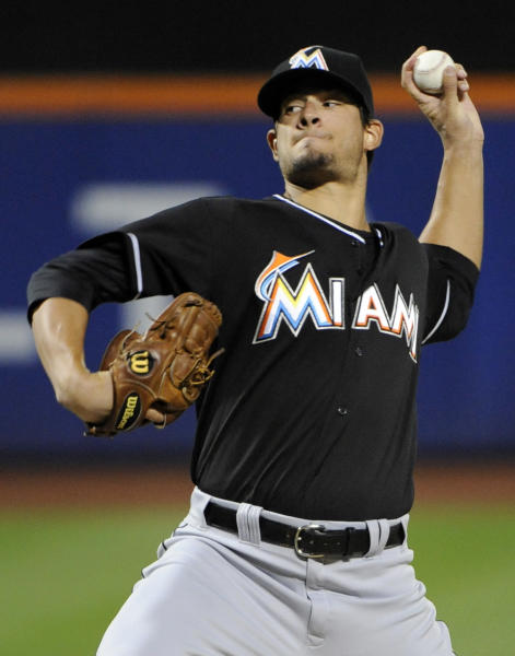 Miami Marlins pitcher Brad Hand delivers the ball to the New York Mets during the first inning of a baseball game on Friday, Sept. 13, 2013, in New York. (AP Photo/Bill Kostroun)