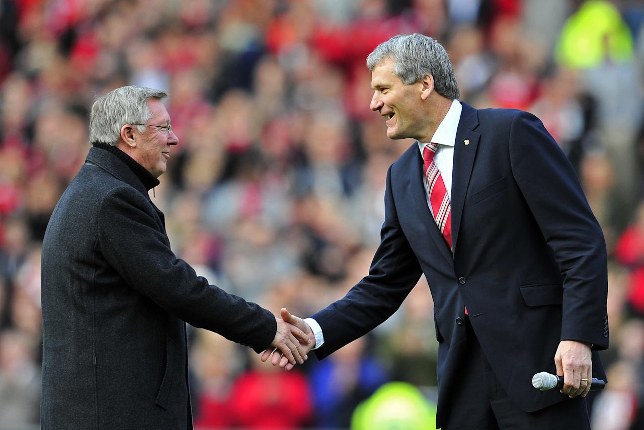 "Manchester United's Scottish manager Sir Alex Ferguson (L) shakes hands with Chief Executive David Gill (R) as he celebrates 25 years in charge before the English Premier League football match between Manchester United and Sunderland at Old Trafford in Manchester, north-west England on November 5, 2011. AFP PHOTO/GLYN KIRK  RESTRICTED TO EDITORIAL USE. No use with unauthorized audio, video, data, fixture lists, club/league logos or ""live"" services. Online in-match use limited to 45 images, no video emulation. No use in betting, games or single club/league/player publications (Photo credit should read GLYN KIRK/AFP/Getty Images)"