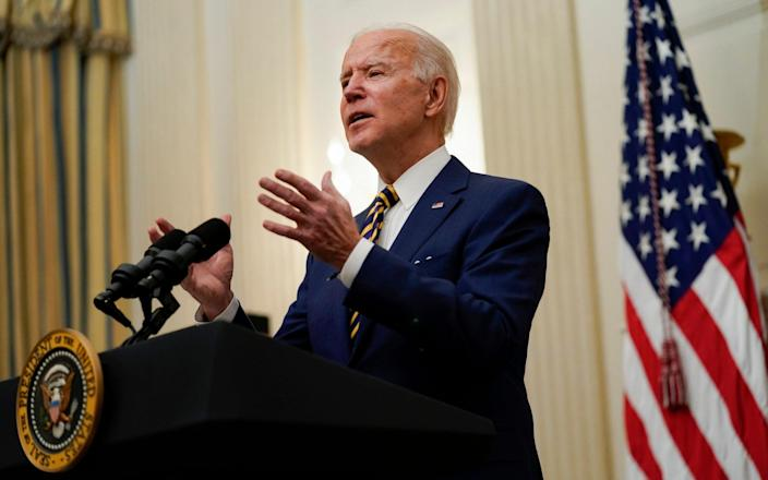 President Joe Biden delivers remarks on the economy in the State Dining Room of the White House in Washington. - AP