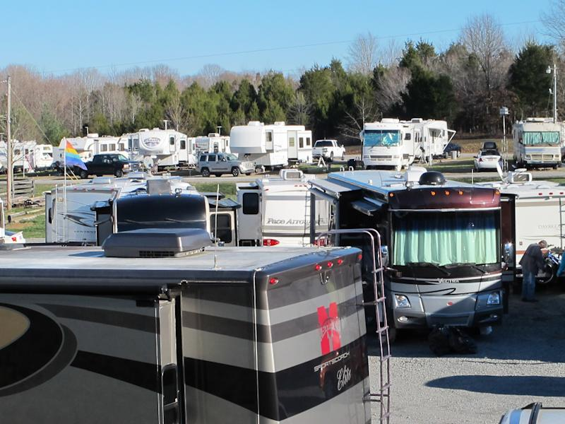RVs are lined up at the Green River Stables campground near Campbellsville, Ky., which has become a Christmas-season tradition. The Amazon.com facility nearby recruits RV owners to come in as seasonal workers to help fill holiday orders. (AP Photo/Bruce Schreiner)