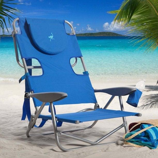 """<h2>Ostrich Reclining Outdoor Beach Camping Lawn Chair</h2><br>Its extra-wide seat, pillowed headrest, drink holder, adjustable reclining positions, and padded carrying straps make this portable chair a summer go-to for beach outings, park picnics, and beyond.<br><br><em>Shop</em> <a href=""""https://www.walmart.com/browse/ostrich/YnJhbmQ6T3N0cmljaAieie"""" rel=""""nofollow noopener"""" target=""""_blank"""" data-ylk=""""slk:Ostrich"""" class=""""link rapid-noclick-resp""""><strong><em>Ostrich</em></strong></a><br><br><strong>Ostrich</strong> Reclining Outdoor Beach Camping Lawn Chair, $, available at <a href=""""https://go.skimresources.com/?id=30283X879131&url=https%3A%2F%2Fwww.walmart.com%2Fip%2FOstrich-On-Your-Back-Folding-Reclining-Outdoor-Beach-Camping-Lawn-Chair-Teal%2F703654517"""" rel=""""nofollow noopener"""" target=""""_blank"""" data-ylk=""""slk:Walmart"""" class=""""link rapid-noclick-resp"""">Walmart</a>"""