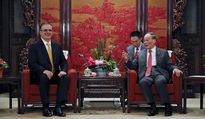 Marcelo Ebrard, Mexico's foreign affairs secretary, speaks with Chinese Vice-President Wang Qishan in Beijing on Monday. Photo: AP