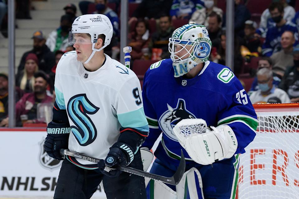 VANCOUVER, BC - OCTOBER 05: Seattle Kraken center Ryan Donato (9) stands in front of Vancouver Canucks goaltender Thatcher Demko (35) during their preseason NHL game on October 5, 2021 at Rogers Arena in Vancouver, British Columbia, Canada. (Photo by Derek Cain/Icon Sportswire via Getty Images)