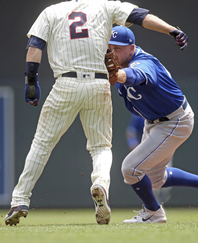 Kansas City Royals first baseman Lucas Duda, right, tags out Minnesota Twins' Brian Dozier during a rundown between first and second in the third inning of a baseball game Wednesday, July 11, 2018, in Minneapolis. (AP Photo/Jim Mone)