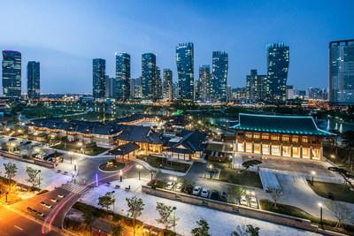 The Songdo International Business District skyline. Developed by New York-based Gale International and Korea's POSCO E&C, the $35 billion Songdo project is the largest Korea-U.S. joint real estate venture ever developed. Built on 1,500 acres of waterfront property, Songdo was designed as a gateway to Northeast Asia and has become an international model for smart-connected cities and city-scale sustainable development. Songdo is located near Incheon International Airport 40 miles southwest of Seoul.