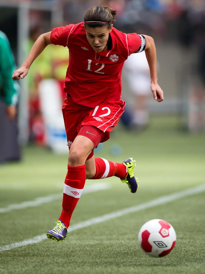 Canada's Christine Sinclair chases down the ball during the first half of an international friendly soccer game against Mexico in Vancouver, British Columbia, on Sunday Nov. 24, 2013. (AP Photo/The Canadian Press, Darryl Dyck)
