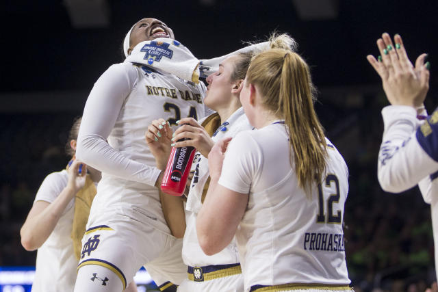 Notre Dame's Arike Ogunbowale (24) celebrates with teammates on the bench during a second-round game against Michigan State in the NCAA women's college basketball tournament in South Bend, Ind., Monday, March 25, 2019. (AP Photo/Robert Franklin)