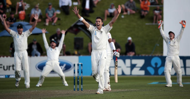 New Zealand's Trent Boult gets the wicket of India's Cheteshwar Pujara (C, obscured) during the first innings on day one of the second international test cricket match at the Basin Reserve in Wellington, February 14, 2014. REUTERS/Anthony Phelps (NEW ZEALAND - Tags: SPORT CRICKET)