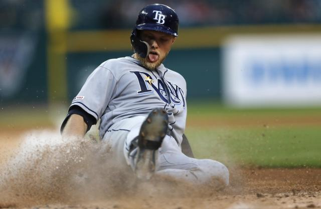 Tampa Bay Rays' Austin Meadows slides into home, scoring on his triple and a throwing error by Detroit Tigers second baseman Harold Castro to third baseman Dawel Lugo during the third inning of a baseball game Wednesday, June 5, 2019, in Detroit. (AP Photo/Carlos Osorio)