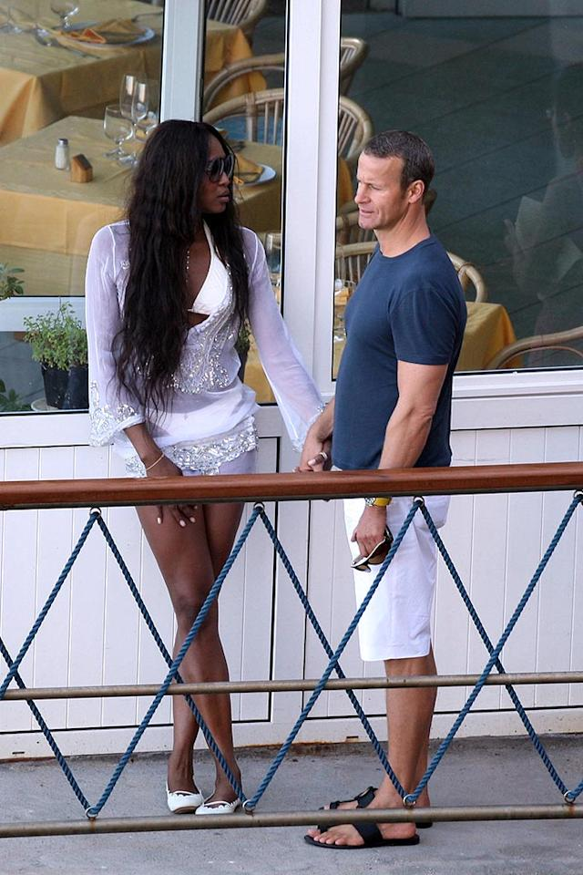 """Naomi Campbell and her beau, Brazilian businessman Marcus Elias, enjoy a moment alone (well, nearly alone) in Capri, Italy. Ciao Pix/<a href=""""http://www.infdaily.com"""" target=""""new"""">INFDaily.com</a> - June 10, 2008"""
