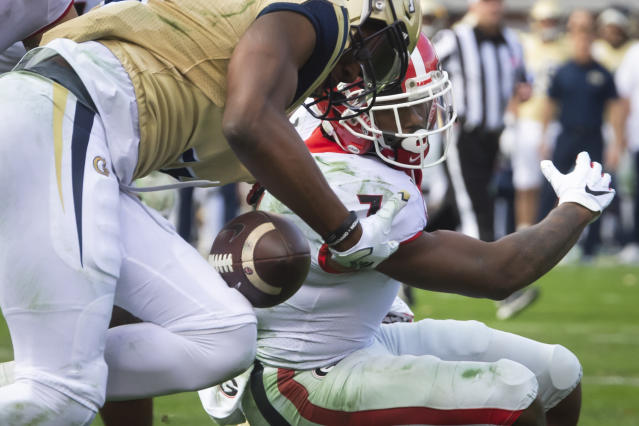 Georgia running back D'Andre Swift fumbles as Georgia Tech defensive back Tre Swilling, left, recovers during the second half of an NCAA college football game Saturday, Nov. 30, 2019 in Atlanta. Georgia won 52-7. (AP Photo/John Amis)