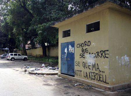 """A graffiti that reads """"Get ready, thief, here we burn you. Regards, Kerdell"""" is seen at a residential block in Valencia"""