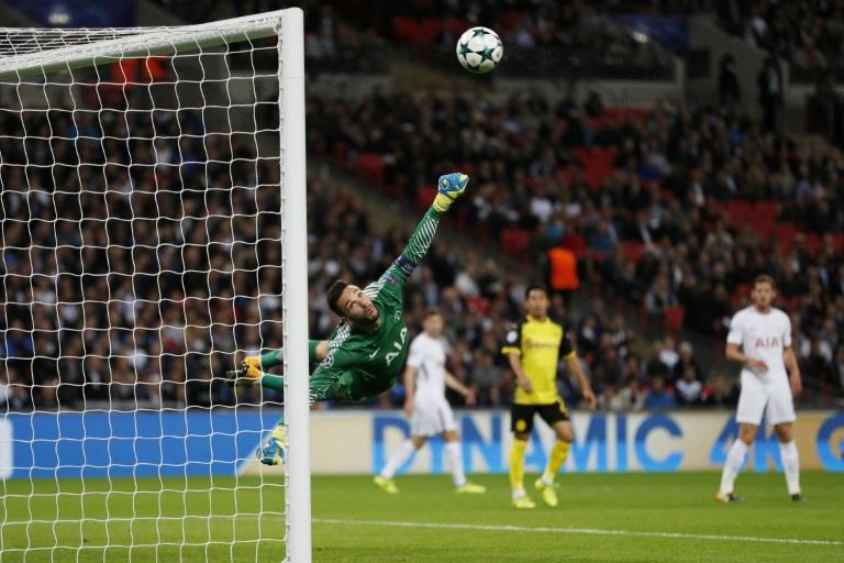 Tottenham Hotspur's goalkeeper Hugo Lloris (L) can't stop a shot by Borussia Dortmund's striker Andriy Yarmolenko during the UEFA Champions League at Wembley Stadium in London, on September 13, 2017