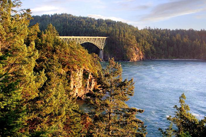"""<p>Just 30 miles north of Seattle sits Whidbey Island, the <a href=""""https://www.cntraveler.com/gallery/the-most-beautiful-places-in-the-pacific-northwest?mbid=synd_yahoo_rss"""" rel=""""nofollow noopener"""" target=""""_blank"""" data-ylk=""""slk:Pacific Northwest"""" class=""""link rapid-noclick-resp"""">Pacific Northwest</a>'s answer to Nantucket. The 55-mile-long island is a mecca for outdoorsy folks, with enough water sports and hiking trails to plan an entire trip around—especially during late spring and early summer. To get a unique sense of space, book a tree-climbing excursion with <a href=""""https://cna.st/affiliate-link/AHcgzb2EnsBUFxBZyrpvpJt6MRLrqZe3k6NsaYDZUrJEb5GcRvFMbsck9J6Kdc5bRNxFX2v8T3MrDaZA5t?cid=6066076c9d9a95de476935ba"""" rel=""""nofollow noopener"""" target=""""_blank"""" data-ylk=""""slk:AdventureTerra"""" class=""""link rapid-noclick-resp"""">AdventureTerra</a>. With the help of ropes and a guide, climbers ascend the island's Coastal Douglas Firs to reach the top of the forest canopy with a bird's eye view of the famous Deception Pass Bridge and neighboring San Juan Islands.</p> <p><strong>Stay here:</strong> Originally built in 1907, the <a href=""""https://cna.st/affiliate-link/2FoCAs6c5FtxgYDBrpSKBTVN5mAeG63JoVeS9av5NSA3B4gxcYkeXryP7DD3mZiFVrHSKPS79bjcMfLgNZvZTSh8NEAXf7nj7vpZYsFMHWYRZLxHW36xmq?cid=6066076c9d9a95de476935ba"""" rel=""""nofollow noopener"""" target=""""_blank"""" data-ylk=""""slk:Captain Whidbey"""" class=""""link rapid-noclick-resp"""">Captain Whidbey</a> inn was rebooted in 2019—and it still remains our favorite place to stay on the island. The six-acre, 30-room property has its own private lagoon and dock, and the best way to arrive is by seaplane at dusk.</p>"""