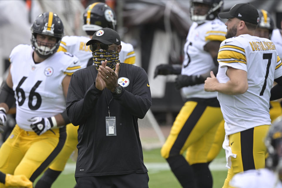 Pittsburgh Steelers head coach Mike Tomlin watches players warm up before an NFL football game against the Jacksonville Jaguars, Sunday, Nov. 22, 2020, in Jacksonville, Fla. (AP Photo/Phelan M. Ebenhack)