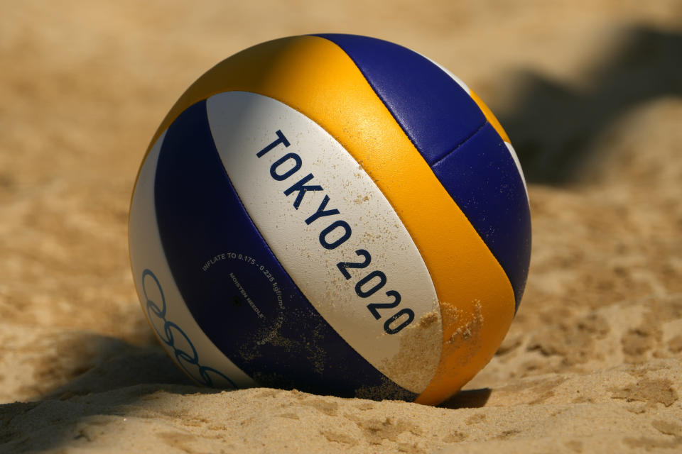 A volleyball rests in the sand during during women's beach volleyball practice at the 2020 Summer Olympics, Monday, July 19, 2021, in Tokyo. (AP Photo/Charlie Riedel)