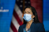 Rep. Deb Haaland, D-N.M., listens as President-elect Joe Biden announces her as his nominee for Secretary of Interior at The Queen Theater in Wilmington Del., Saturday, Dec. 19, 2020. (AP Photo/Carolyn Kaster)