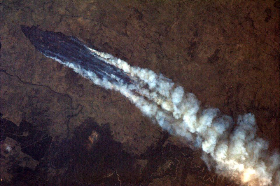 """The Australian bushfires, this one near Burrinjuck Dam. Look closely and you can see the flames from orbit. <a href=""""https://twitter.com/Cmdr_Hadfield/status/289147637842731009/photo/1"""" rel=""""nofollow noopener"""" target=""""_blank"""" data-ylk=""""slk:(Photo by Chris Hadfield/Twitter)"""" class=""""link rapid-noclick-resp"""">(Photo by Chris Hadfield/Twitter)</a>"""