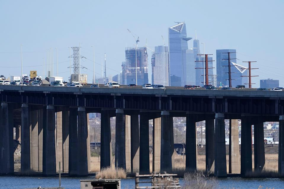 "Cars travel on a raised expressway in Kearny, N.J., Tuesday, April 6, 2021. President Joe Biden is setting about convincing America it needs his $2.3 trillion infrastructure plan, deputizing a five-member ""jobs Cabinet"" to help in the effort."