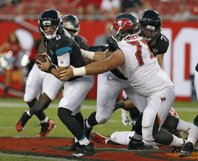 Tampa Bay Buccaneers defensive tackle Nathan Bazata (73) sacks Jacksonville Jaguars quarterback Cody Kessler (6) during the first half of an NFL preseason football game Thursday, Aug. 30, 2018, in Tampa, Fla. (AP Photo/Mark LoMoglio)
