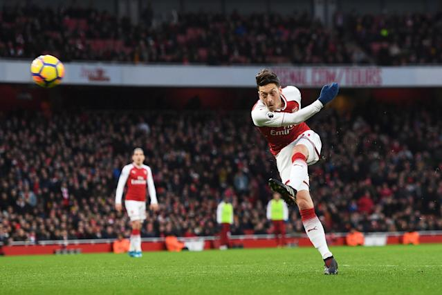 "Mesut Ozil scores a brilliant goal for Arsenal against <a class=""link rapid-noclick-resp"" href=""/soccer/teams/newcastle-united/"" data-ylk=""slk:Newcastle United"">Newcastle United</a> at the Emirates on Saturday. (Getty)"