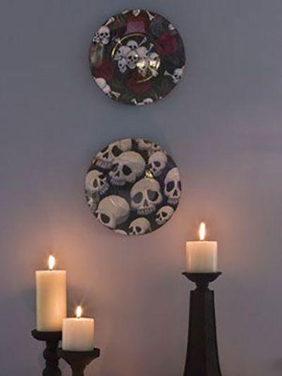 """<p>Cover clear plates with cotton fabric to create these simple decorations. </p><p><a href=""""https://www.womansday.com/home/crafts-projects/how-to/a3062/halloween-crafts-skull-plates-21990/"""" rel=""""nofollow noopener"""" target=""""_blank"""" data-ylk=""""slk:Get the tutorial for Skull Plates."""" class=""""link rapid-noclick-resp""""><em>Get the tutorial for Skull Plates.</em></a></p><p><strong>What You'll Need</strong>: <a href=""""https://www.amazon.com/Duralex-Lys-Clear-Dinner-Plate/dp/B0108BRMT2/ref=sr_1_5?keywords=clear+glass+plate&qid=1563292033&s=gateway&sr=8-5&tag=syn-yahoo-20&ascsubtag=%5Bartid%7C10070.g.2488%5Bsrc%7Cyahoo-us"""" rel=""""nofollow noopener"""" target=""""_blank"""" data-ylk=""""slk:Clear glass plates"""" class=""""link rapid-noclick-resp"""">Clear glass plates</a> ($30 for 6, Amazon); <a href=""""https://www.amazon.com/Yard-multicolor-estampado-digital-lunarable/dp/B07NWC4F8L?tag=syn-yahoo-20&ascsubtag=%5Bartid%7C10070.g.2488%5Bsrc%7Cyahoo-us"""" rel=""""nofollow noopener"""" target=""""_blank"""" data-ylk=""""slk:Skull-print fabric"""" class=""""link rapid-noclick-resp"""">Skull-print fabric</a> ($17 for 1 yard, Amazon)</p>"""
