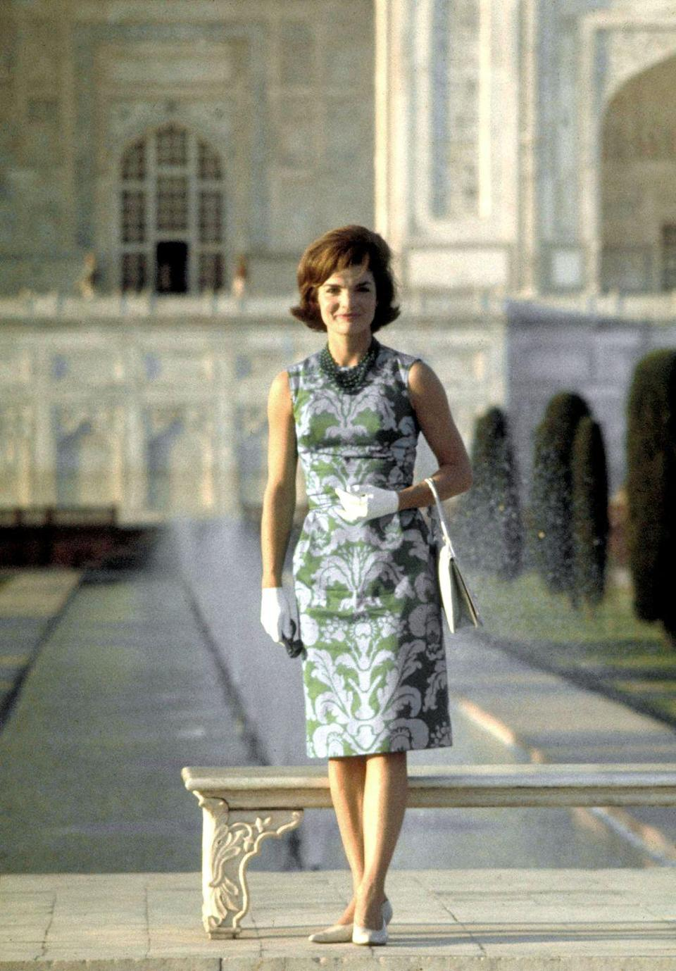 <p>Jackie Kennedy poses in front of the Taj Mahal on a visit to India.</p>