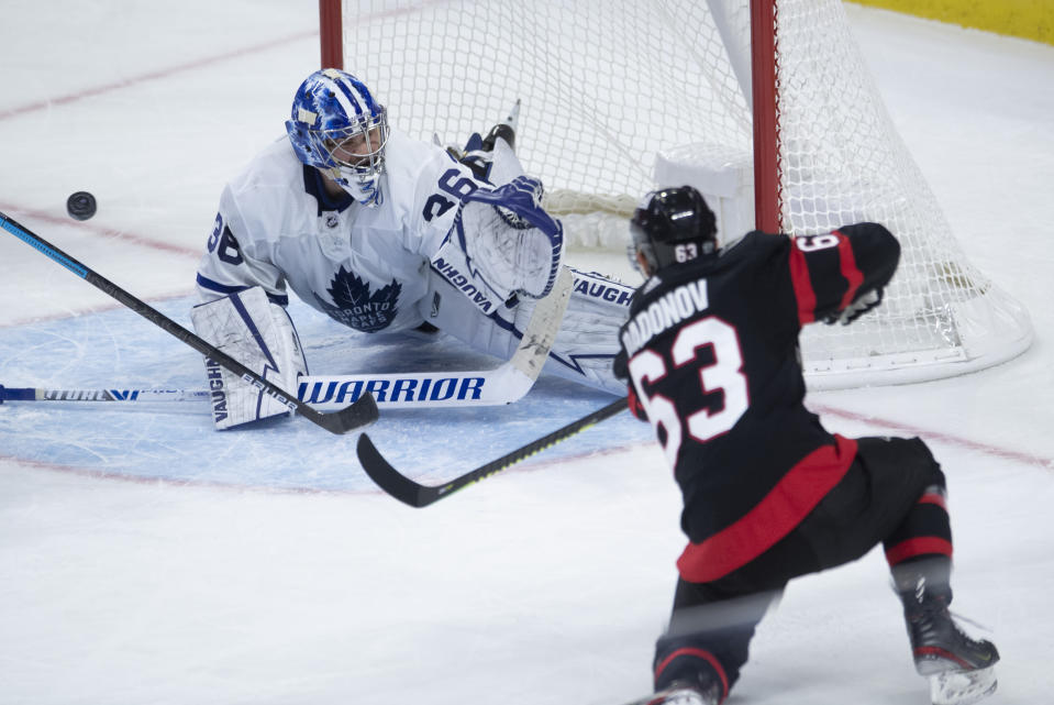 Ottawa Senators right wing Evgenii Dadonov gets the puck past Toronto Maple Leafs goaltender Jack Campbell during the third period of an NHL hockey game in Ottawa, Ontario, Saturday, Jan. 16, 2021. (Adrian Wyld/The Canadian Press via AP)