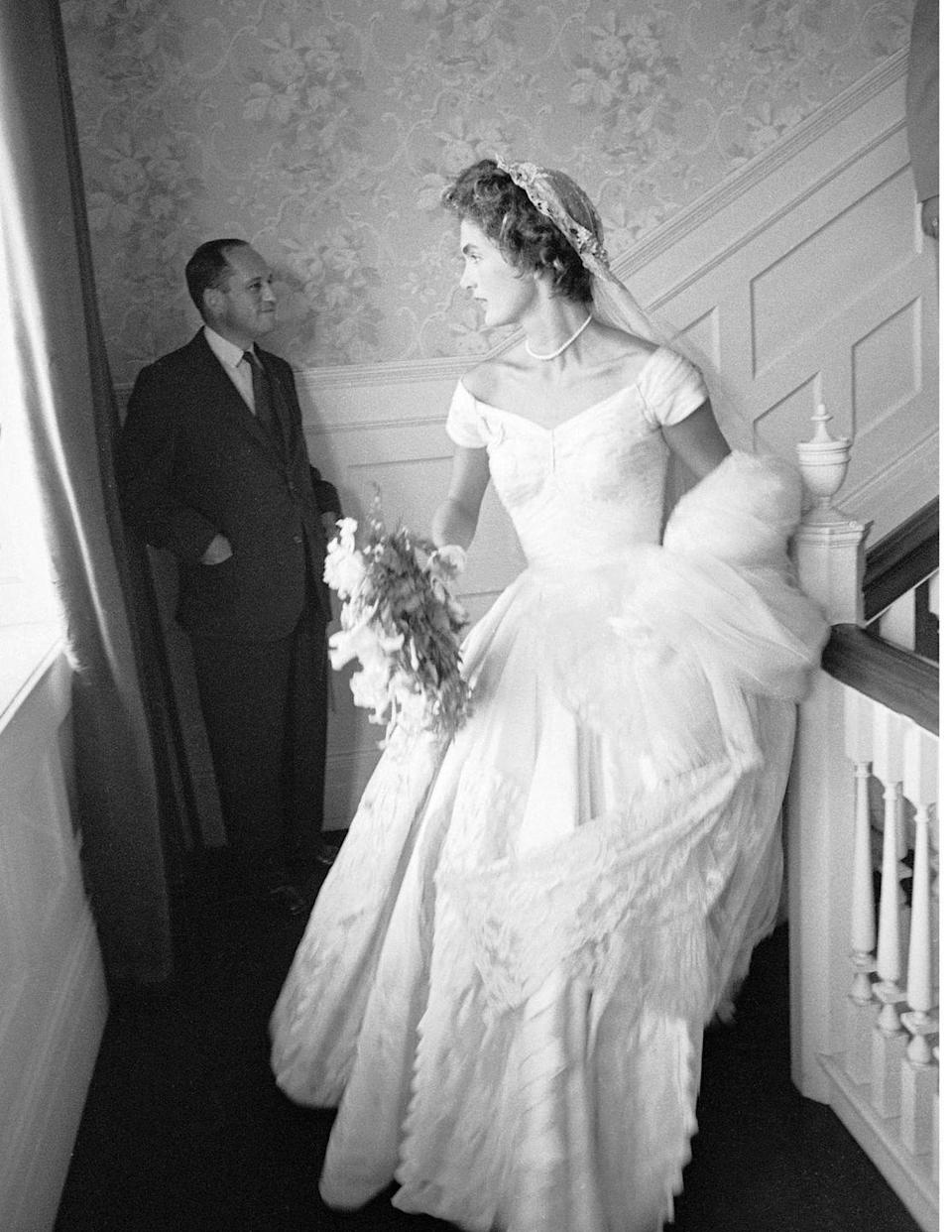 <p>The new bride made her way downstairs to awaiting guests.</p>