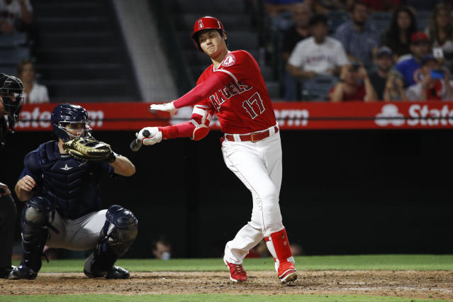Los Angeles Angels' Shohei Ohtani strikes out during the ninth inning of the team's baseball game against the Seattle Mariners, Wednesday, July 11, 2018, in Anaheim, Calif. The Mariners won 3-0. (AP Photo/Jae C. Hong)