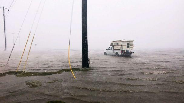 PHOTO: Craig 'Cajun' Uggen, 57, nearly floods his truck as Hurricane Harvey comes ashore in Corpus Christi, Texas, Aug. 25, 2017. (Brian Thevenot/Reuters)