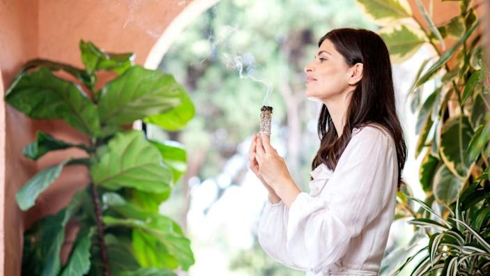 HOLLYWOOD, CA-July 5, 2019: Breathwork practitioner, Ana Lilia, during a photo shoot at her house in Hollywood on Friday, July 5, 2019. Lilia uses a myriad of methods in her energy work, including sage and crystals, to help facilitate the release of blocked energy and emotion for her clients. (Mariah Tauger / Los Angeles Times)
