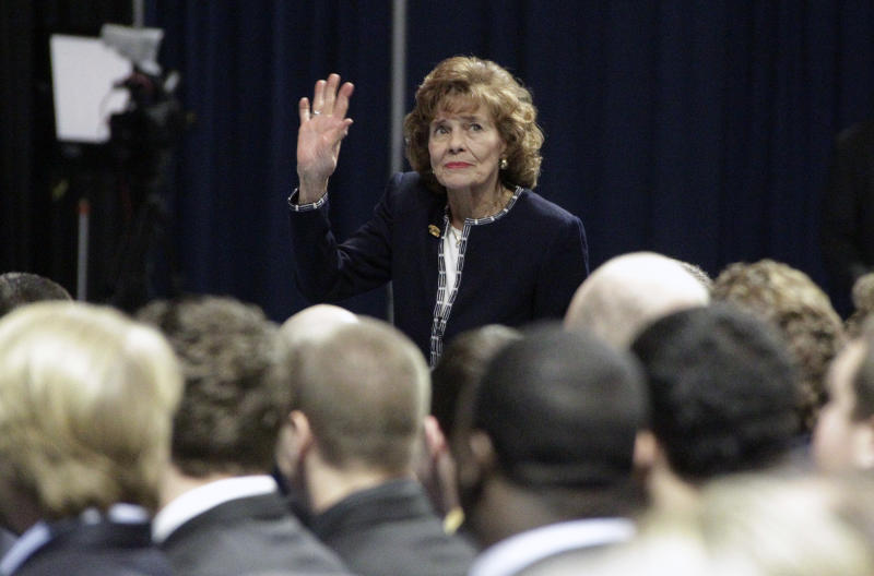 FILE - This Jan. 26, 2012 file photo, shows Sue Paterno, wife of former Penn State football coach Joe Paterno, waves to well-wishers as she enters a memorial service for her husband at Penn State's Bryce Jordan Center in State College, Pa. Joe Paterno earned a state pension of $13.4 million for his 61-year coaching career at Penn State. Paterno's family announced Tuesday, May 22, 2012, through a spokesman that Paterno's widow, Sue, would receive an initial payment of $10.1 million by the end of May, with the rest to be paid out over the next two years. (AP Photo/Gene J. Puskar, File)