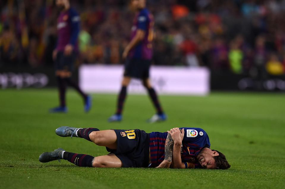 Lionel Messi suffered a broken arm during Barcelona's game against Sevilla. (Getty)